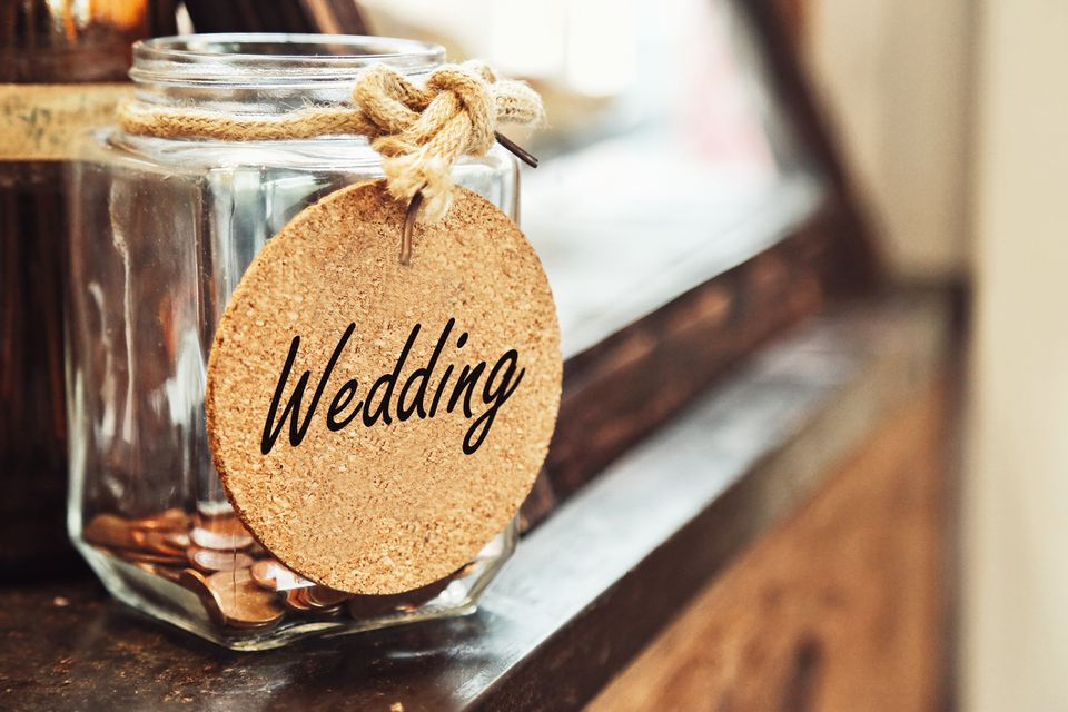 Wedding jar filled with pennies.