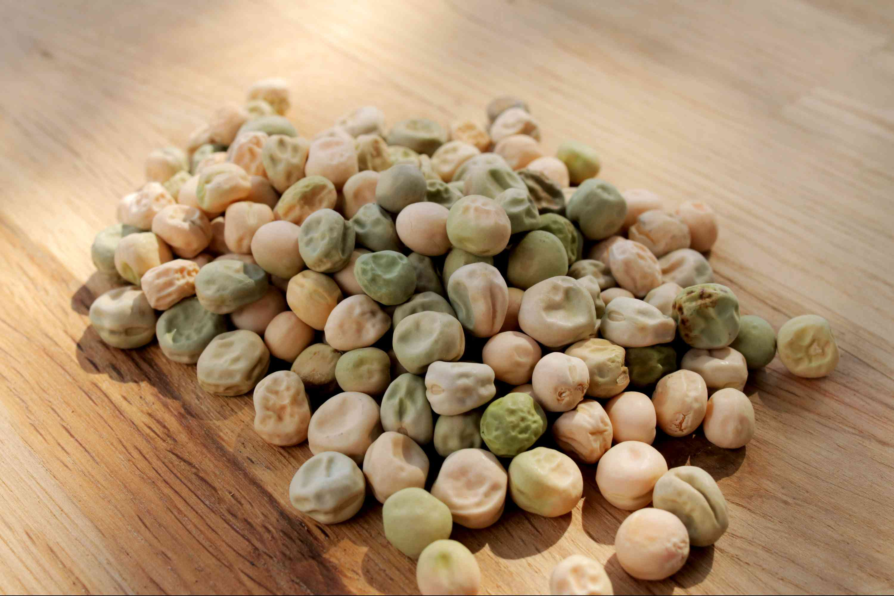Pea seeds on wooden surface