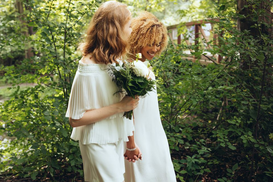 Couple on their wedding day in a wooded area