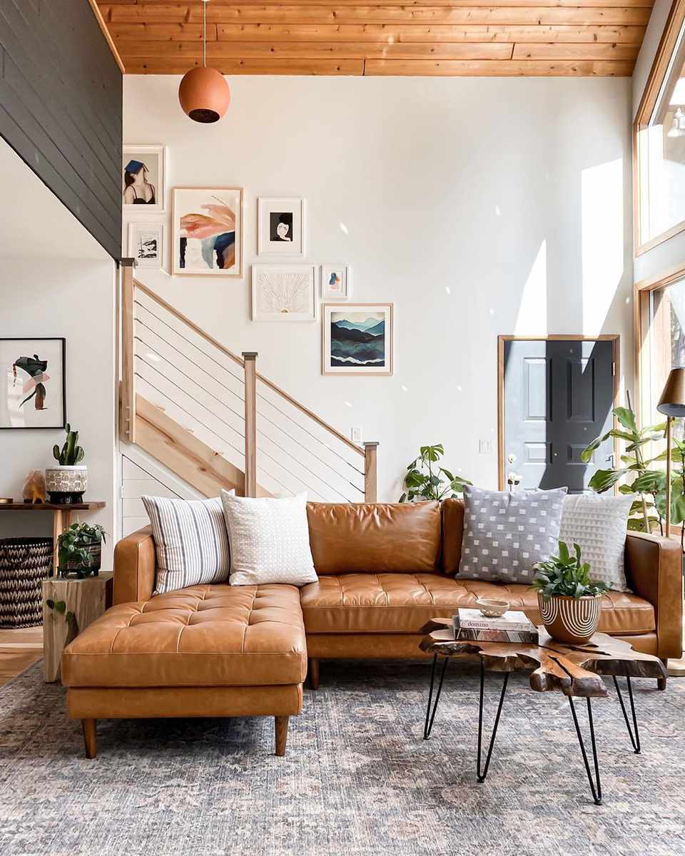 Open living room with staircase and gallery wall