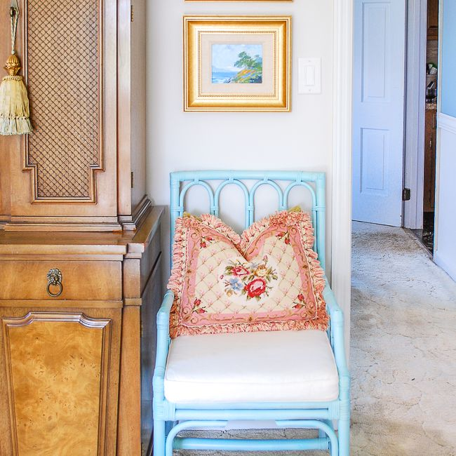 blue chair with frilly pink pillow