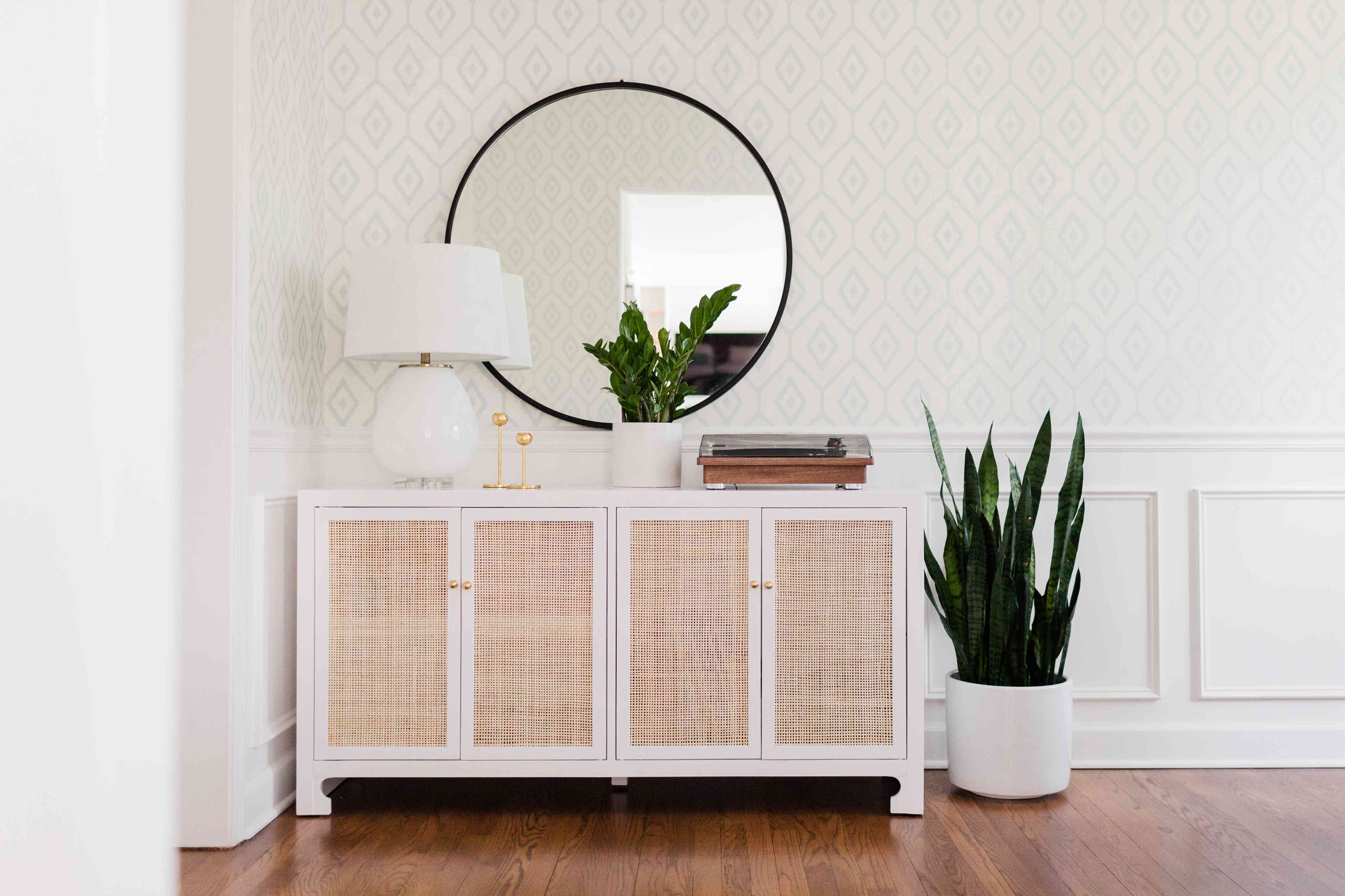 mirror on a wall in a light, airy interior