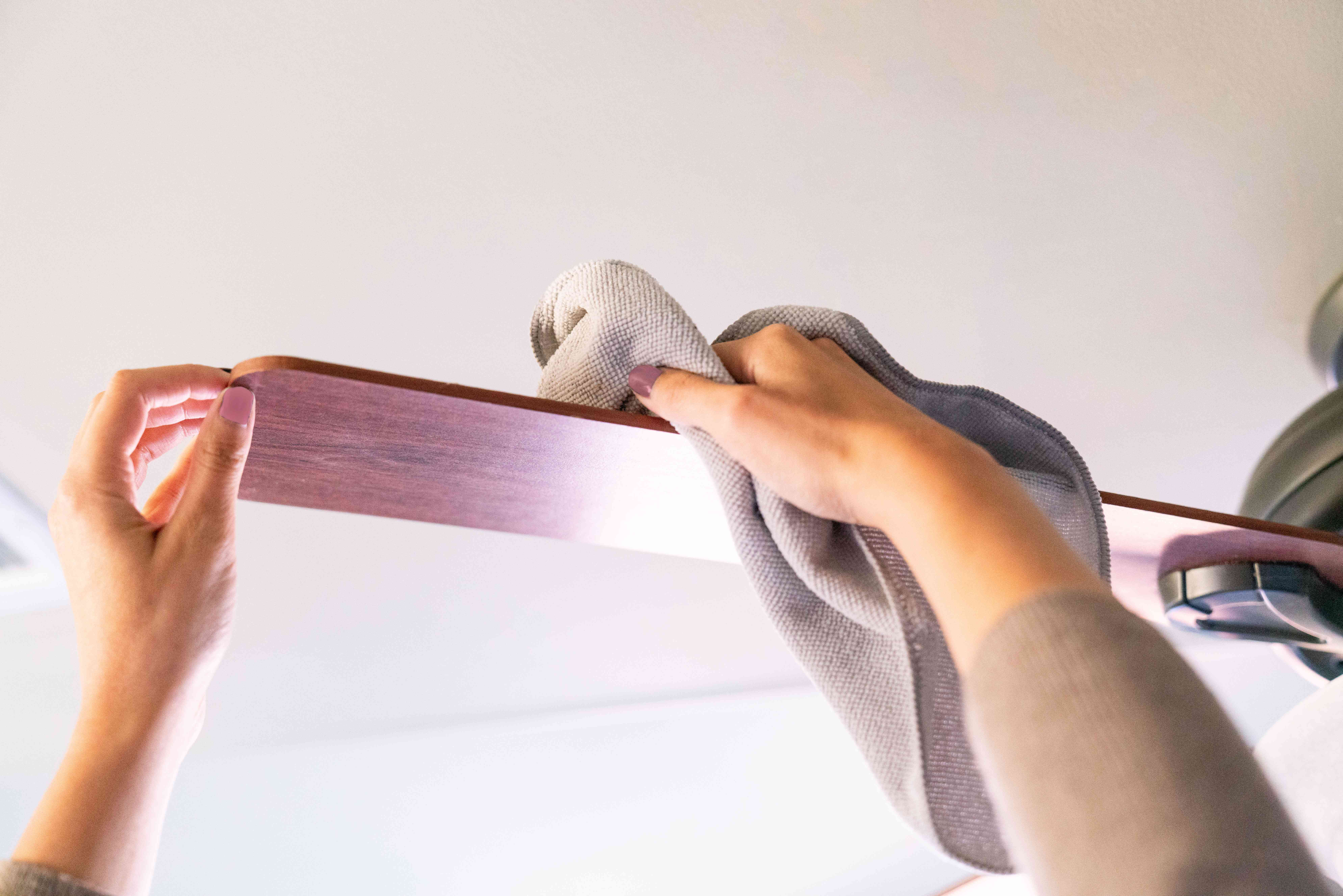 dusting the ceiling fan