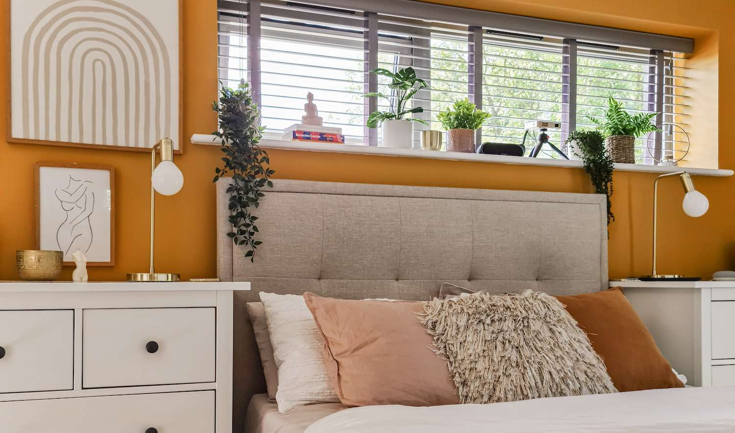 bedroom with mustard color back wall, modern decor