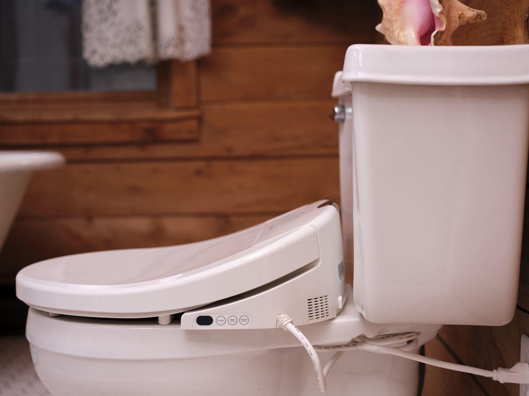 pink bidet / toilet in a bathroom