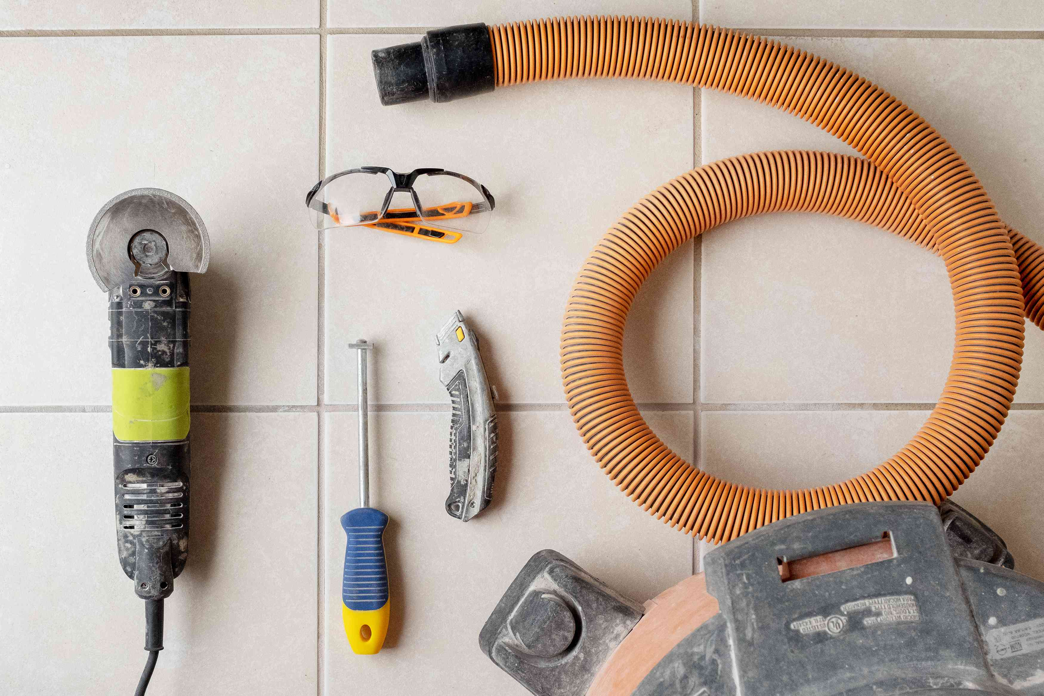 Tile grout removal tools