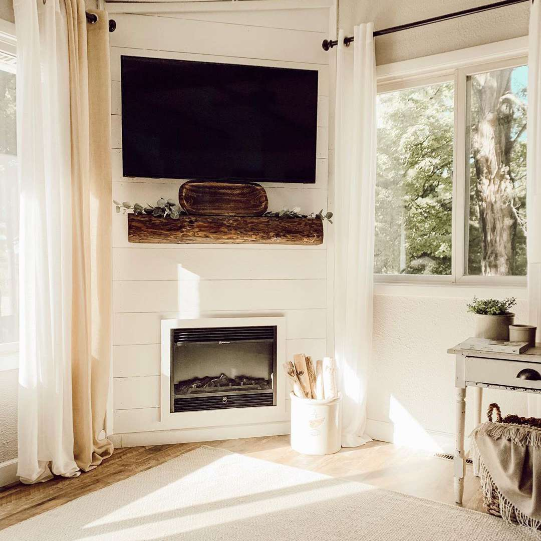 Tv over a faux electric fireplace