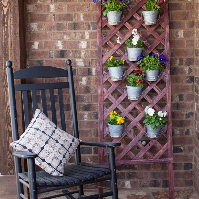 Flowers on a lattice wall on a porch