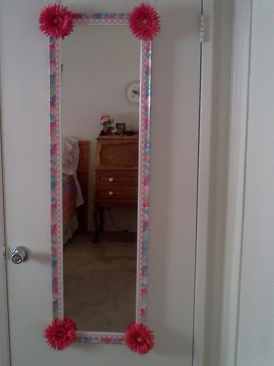 Duct tape framing a mirror