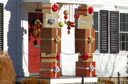 porch columns decorated with christmas gift boxes