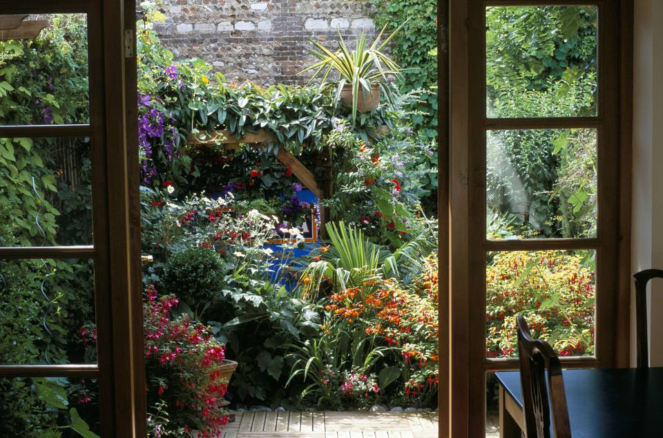 View through French windows to small courtyard garden