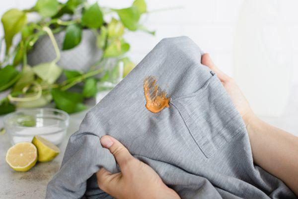 Orange food stain on gray shirt held up