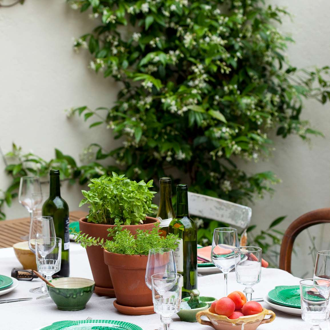 table setting with lots of greenery