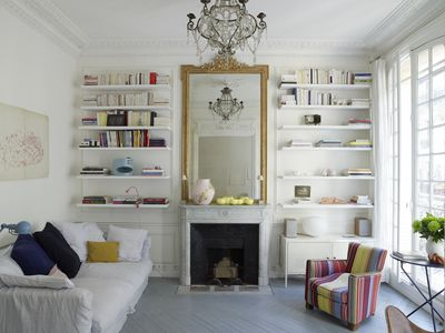 A living room with prominent mirror