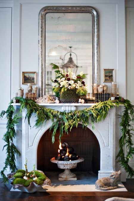 Garlands Of Greenery Above A Fireplace Living Room Mantel Decoration
