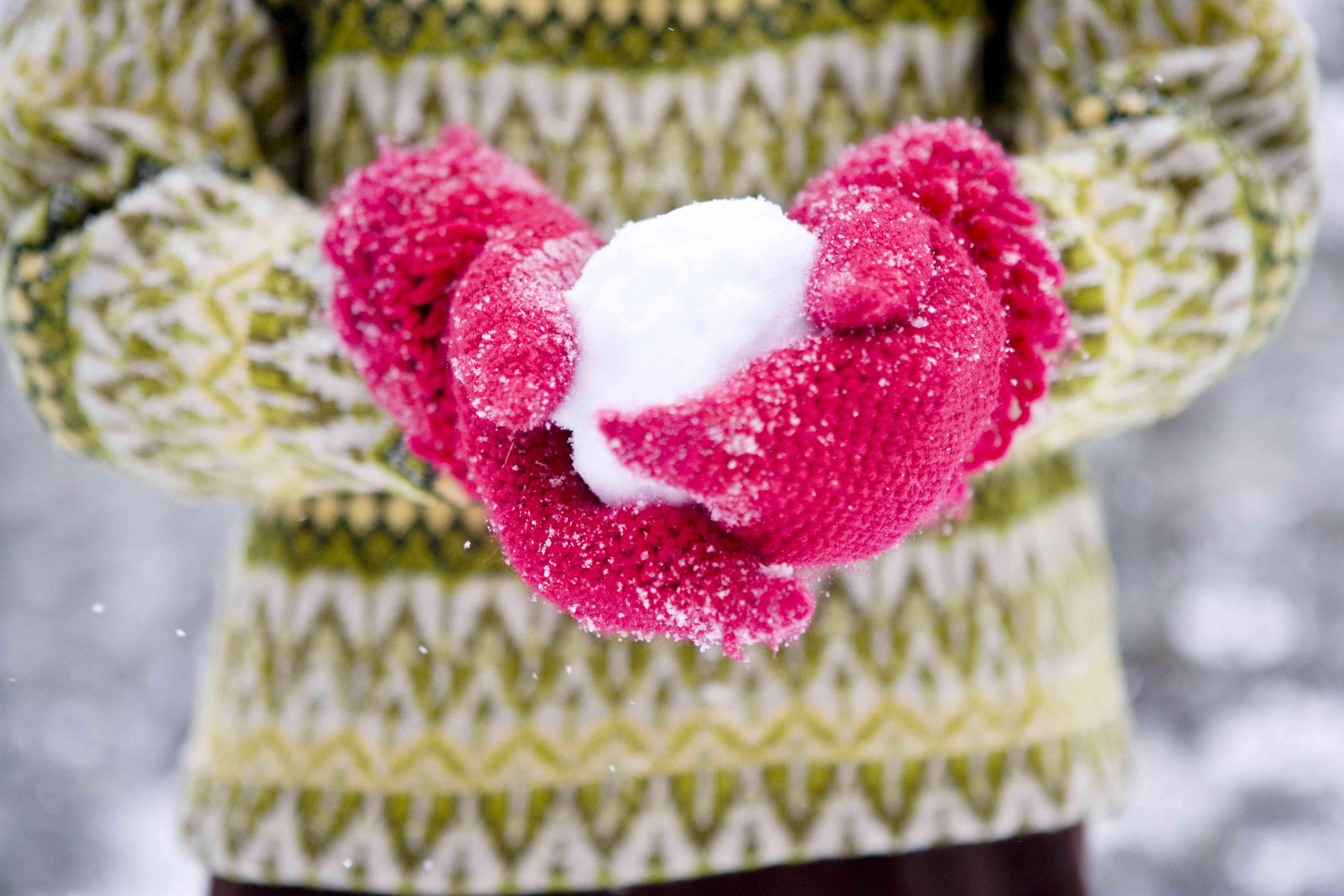 A woman making snowballs Sweden.