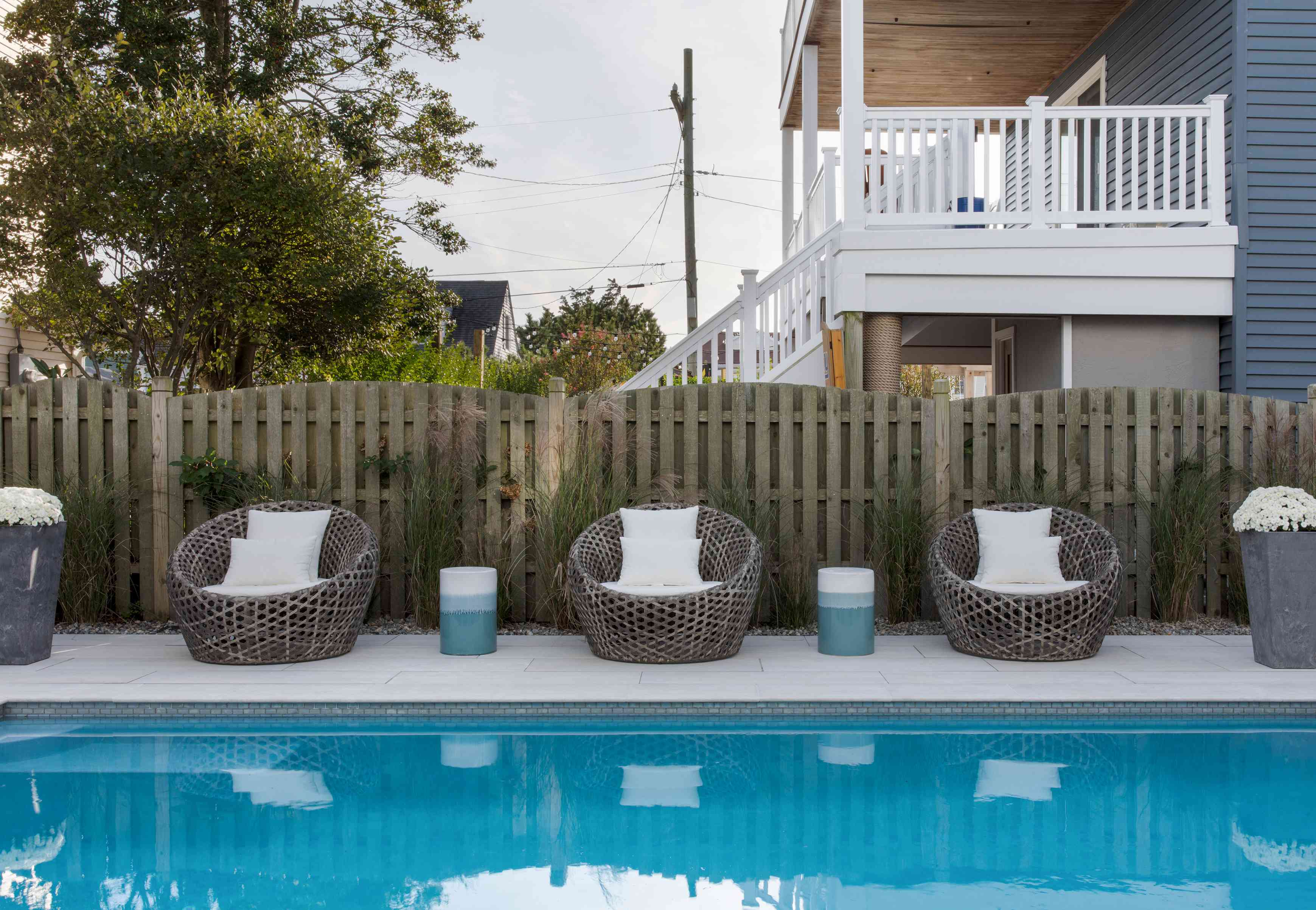 Cocoon chairs surround the pool at the Long Beach Island home of Karen B. Wolfe