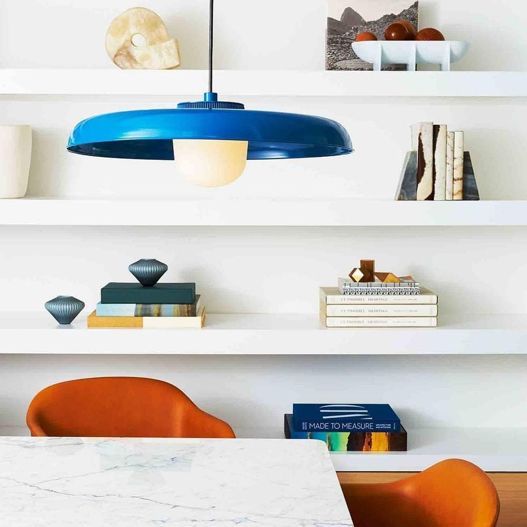 Table with a bold blue pendant lamp
