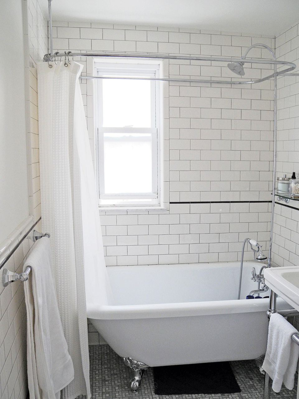 White Subway Tiles and Clawfoot Tub in Remodeled Bathroom