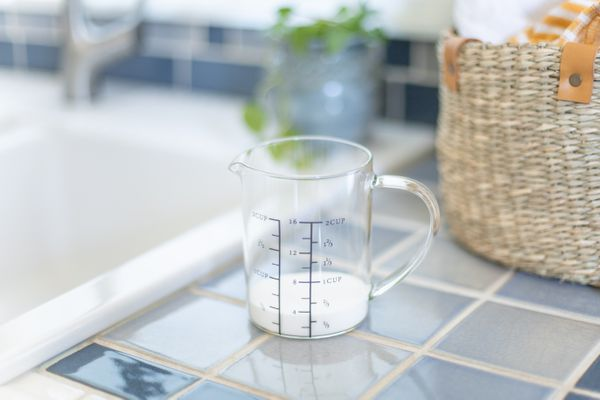 laundry detergent in a measuring cup