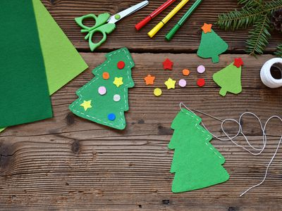 Making of handmade christmas tree from felt with your own hands. Children's DIY concept. Making xmas toys decoration or greeting card.