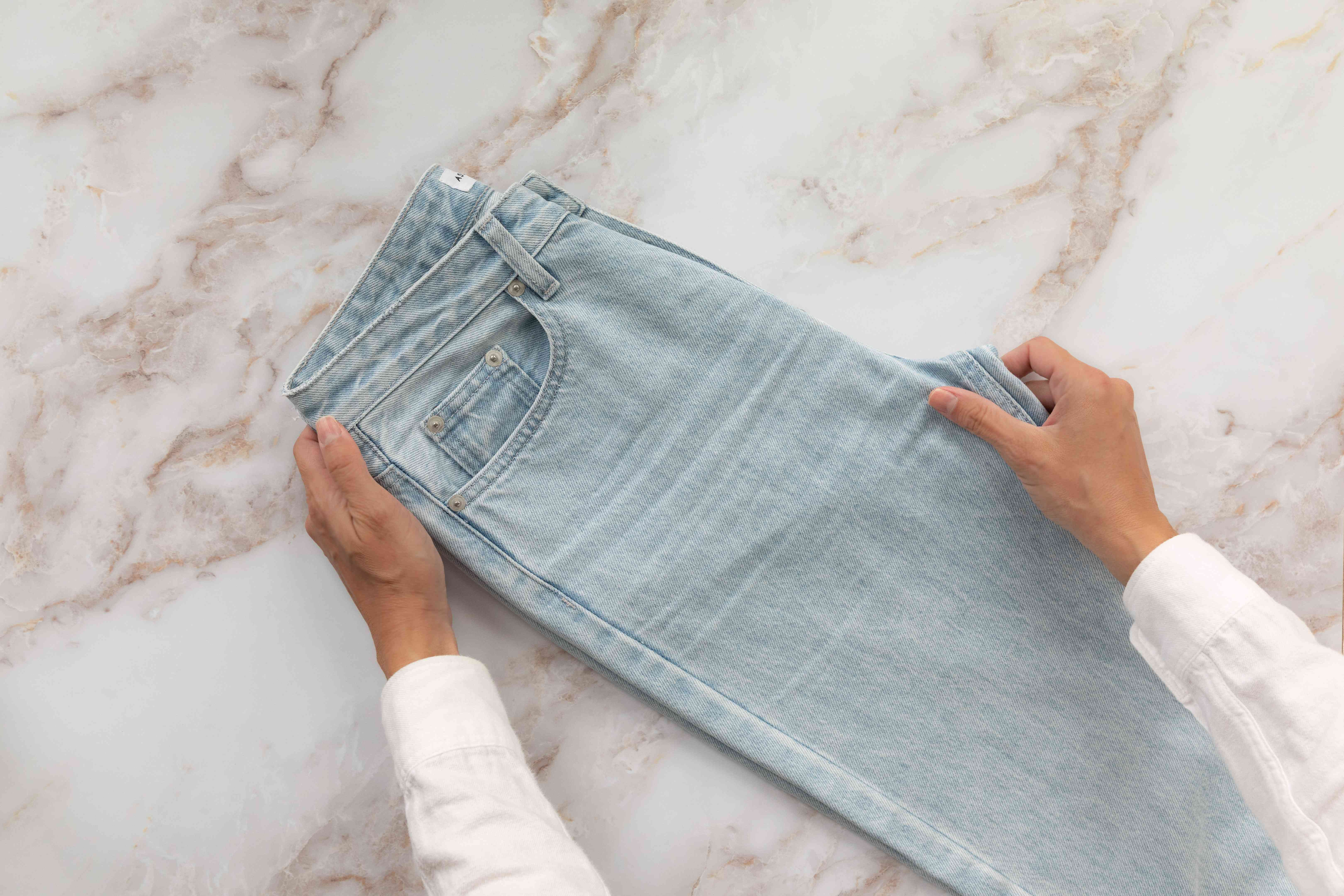 Jeans without crease folded in half vertically