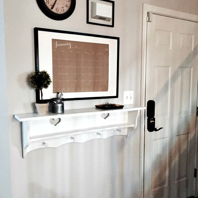 An entryway with a key rack and calendar.