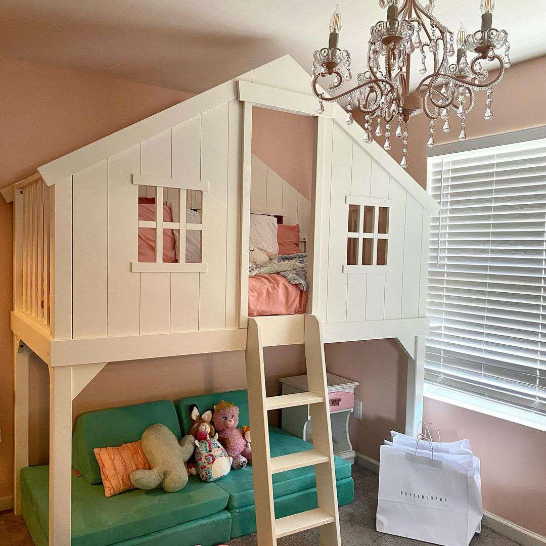 A kid's loft that looks like a playhouse with faux windows.
