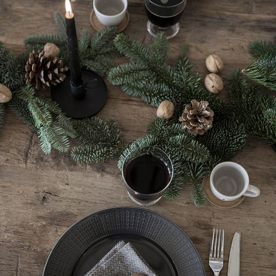 Wooden table with black-themed table setting.