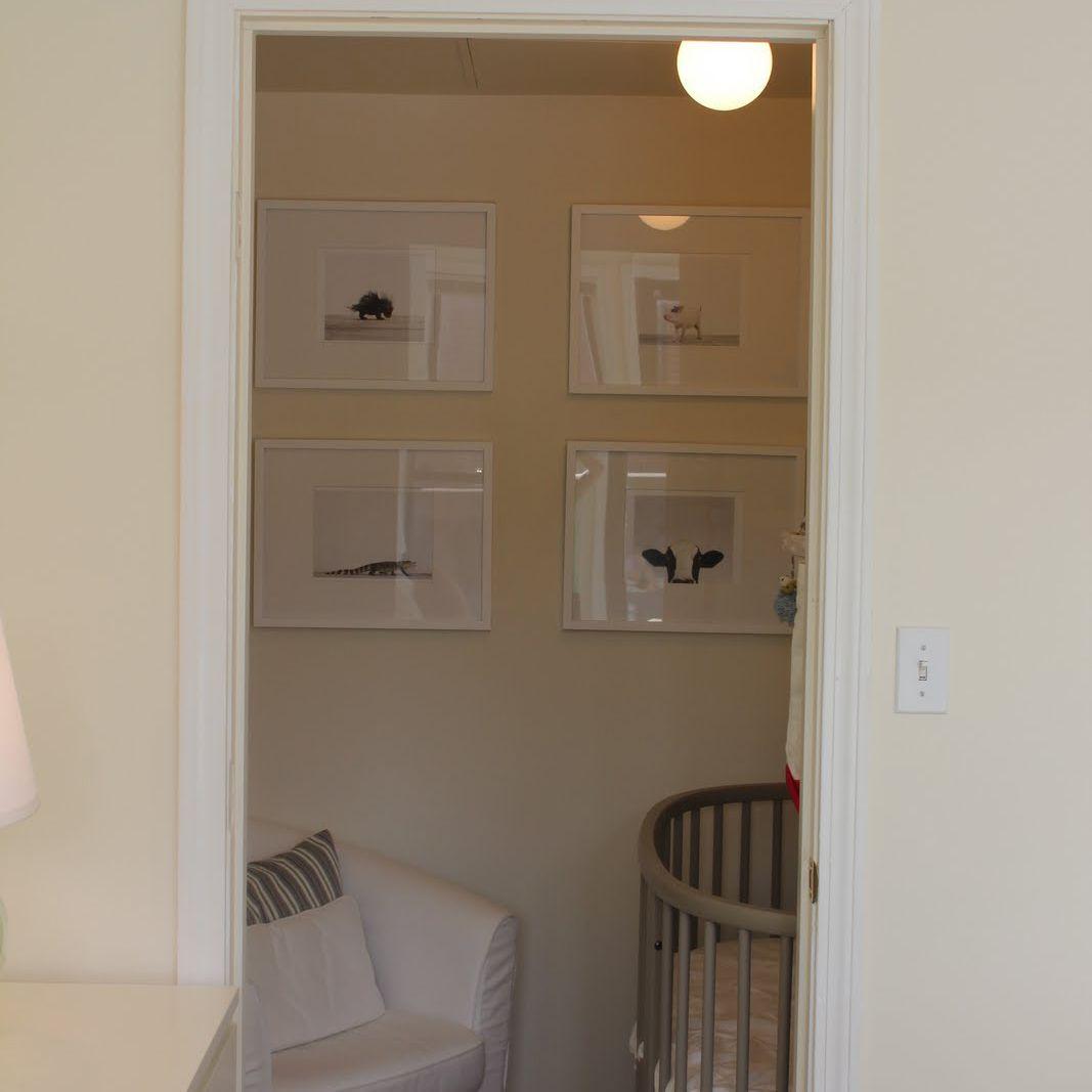 Neutral closet nursery with round crib