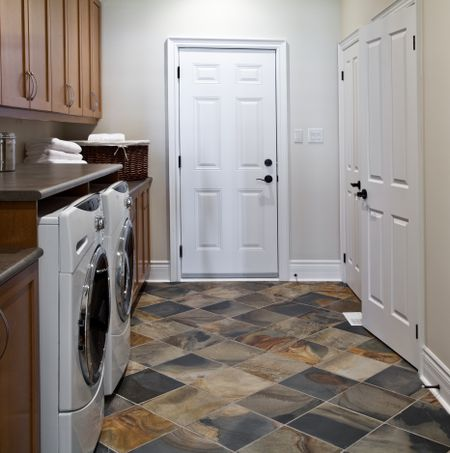 A Basic Laundry Room With White Doors