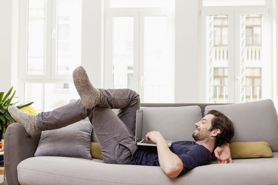 Man Lying on Sofa