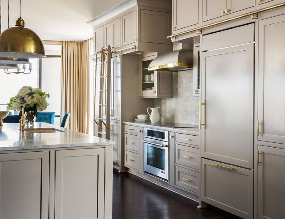 Brass Fixtures, Cream Kitchen Cabinets