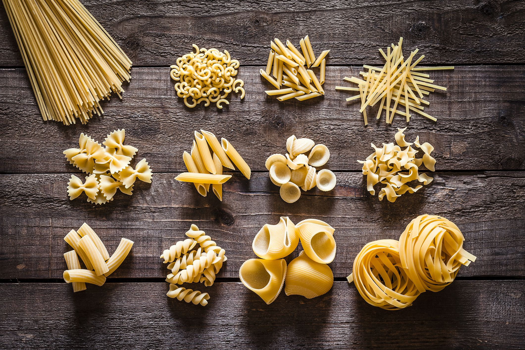 Different varieties of dry pasta on a table.