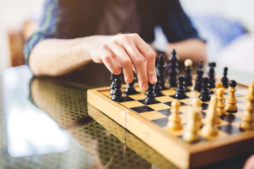 Close up of man playing chess