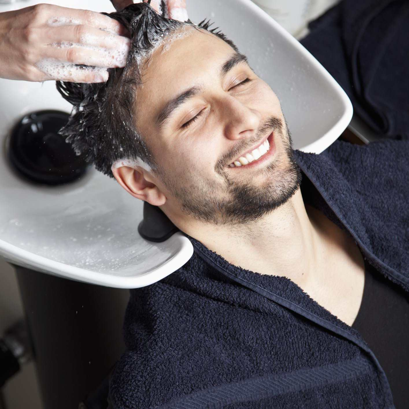 A man having his hair washed at a hair salon