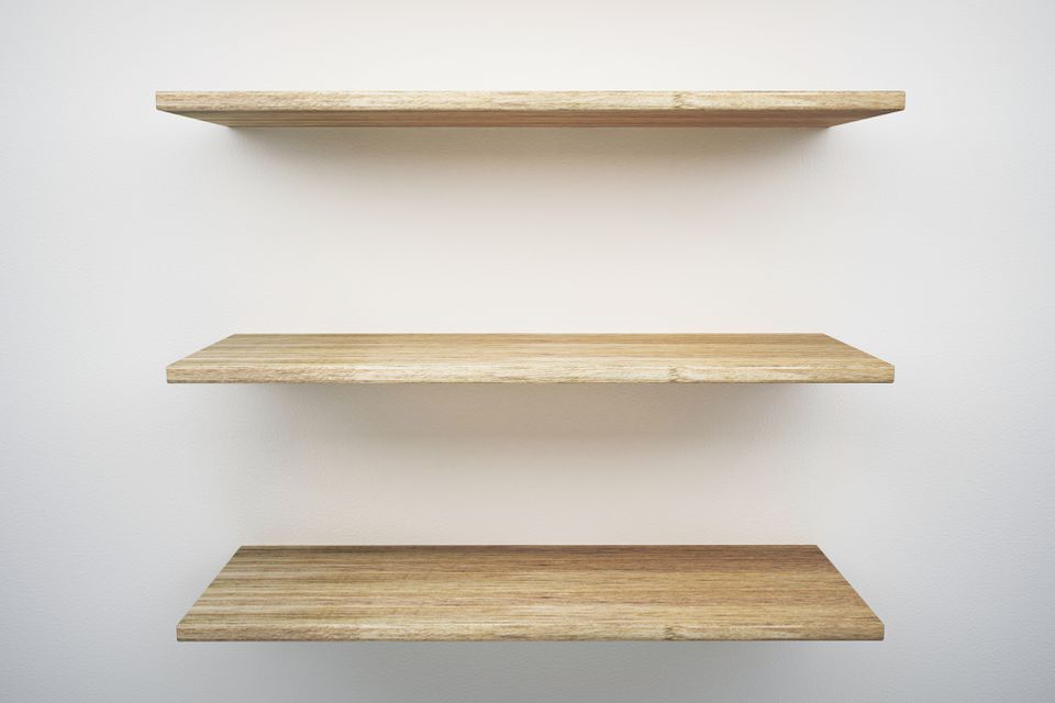 Wooden Shelves Mounted On White Wall
