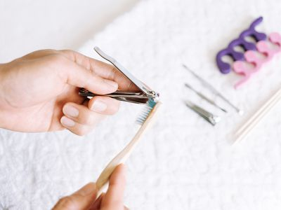 person cleaning nail clippers