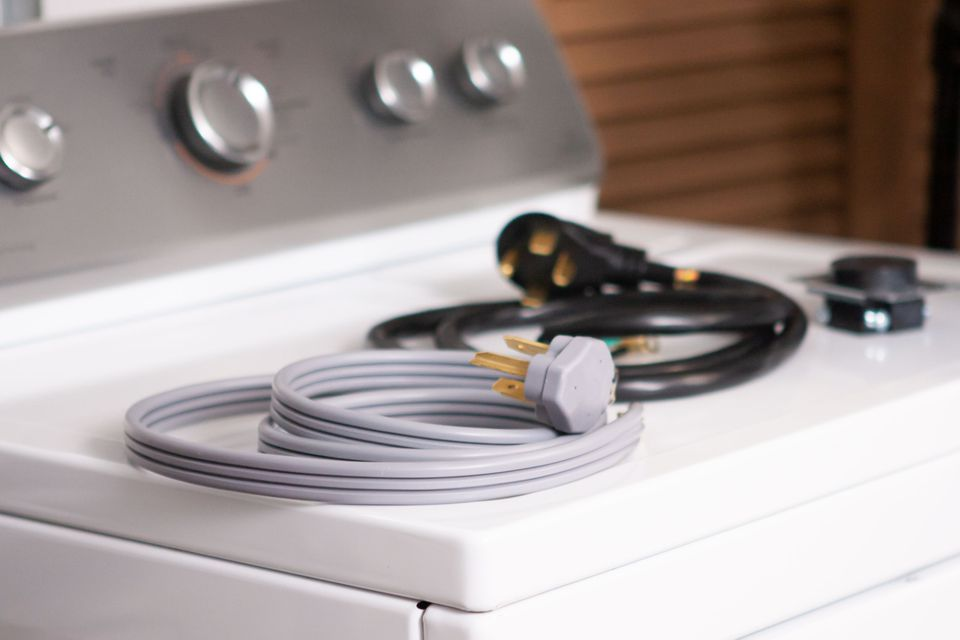 3 and 4 prong dryer cords on top of a dryer