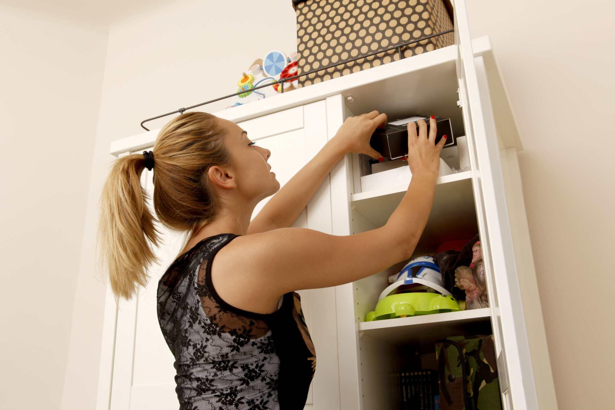 Woman organizing a closet