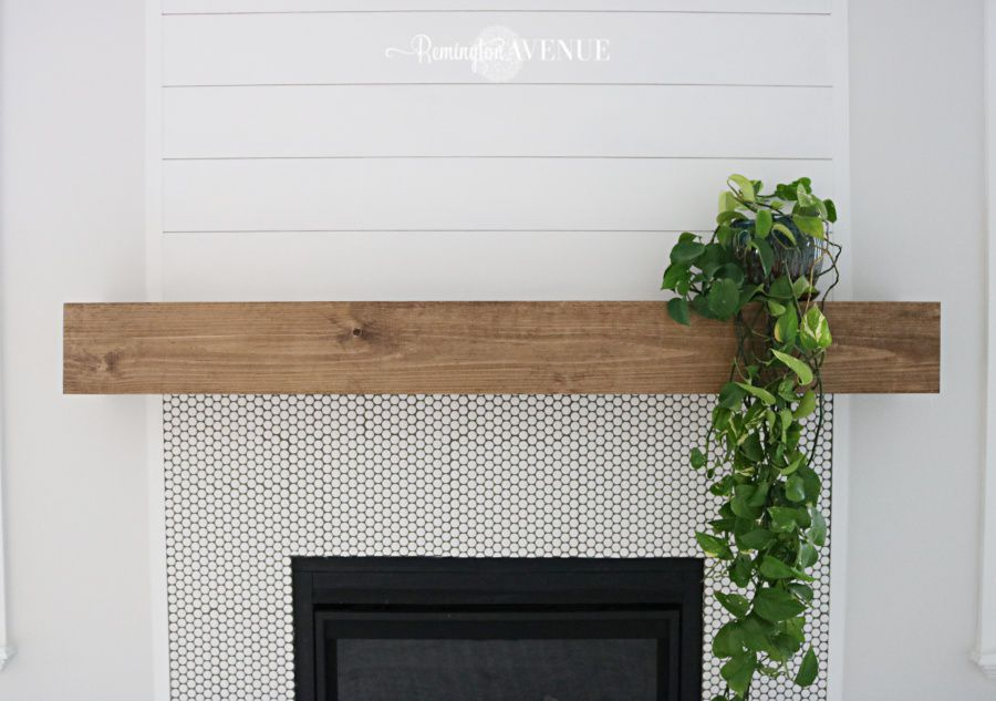Reclaimed wood mantel over fireplace.