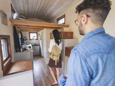 Couple walking inside of new tiny home