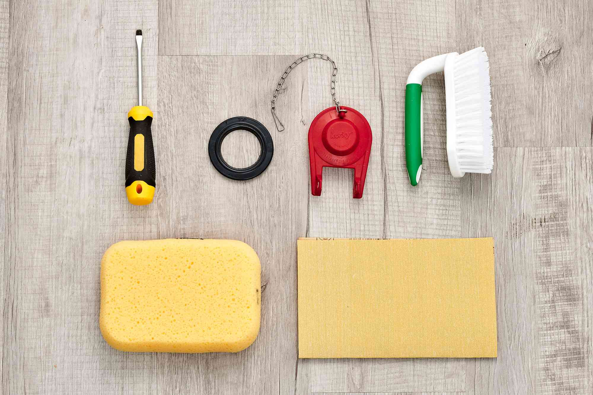 Materials and tools to replace a leaky toilet flush valve