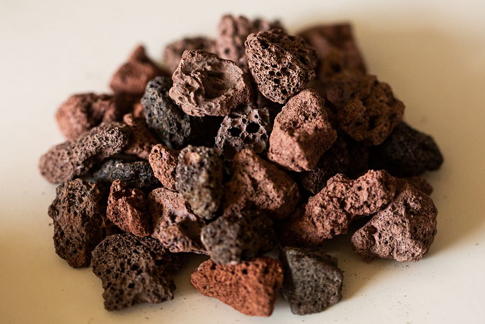 Pile of brown lava rocks for orchid growing material closeup