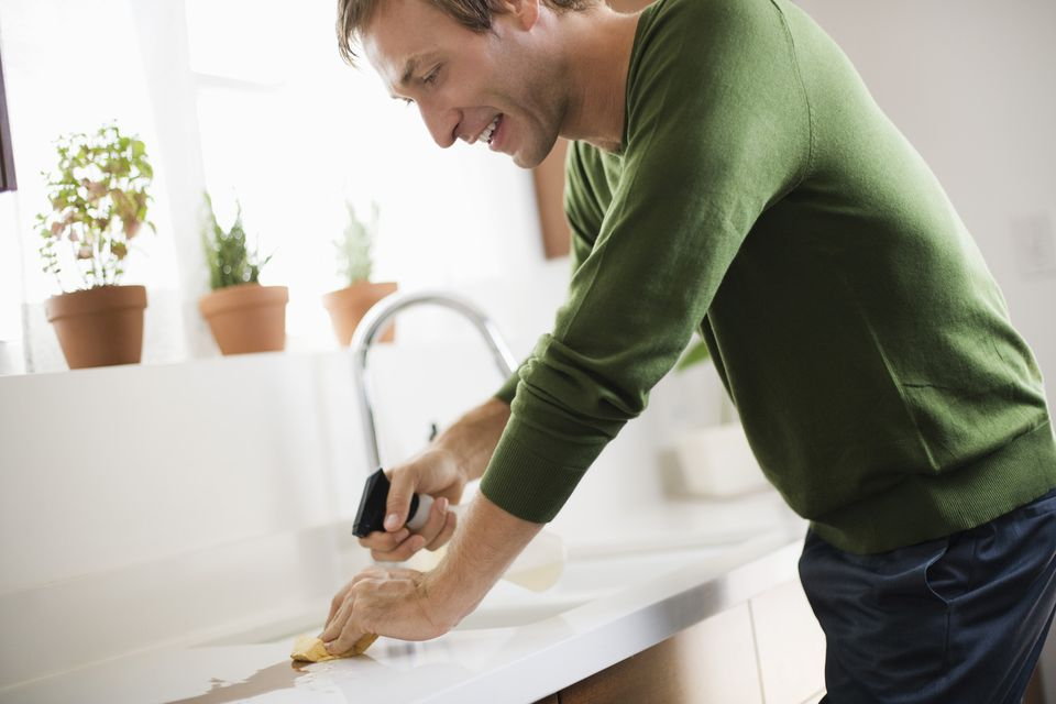 Man cleaning counter with eco-friendly cleaner