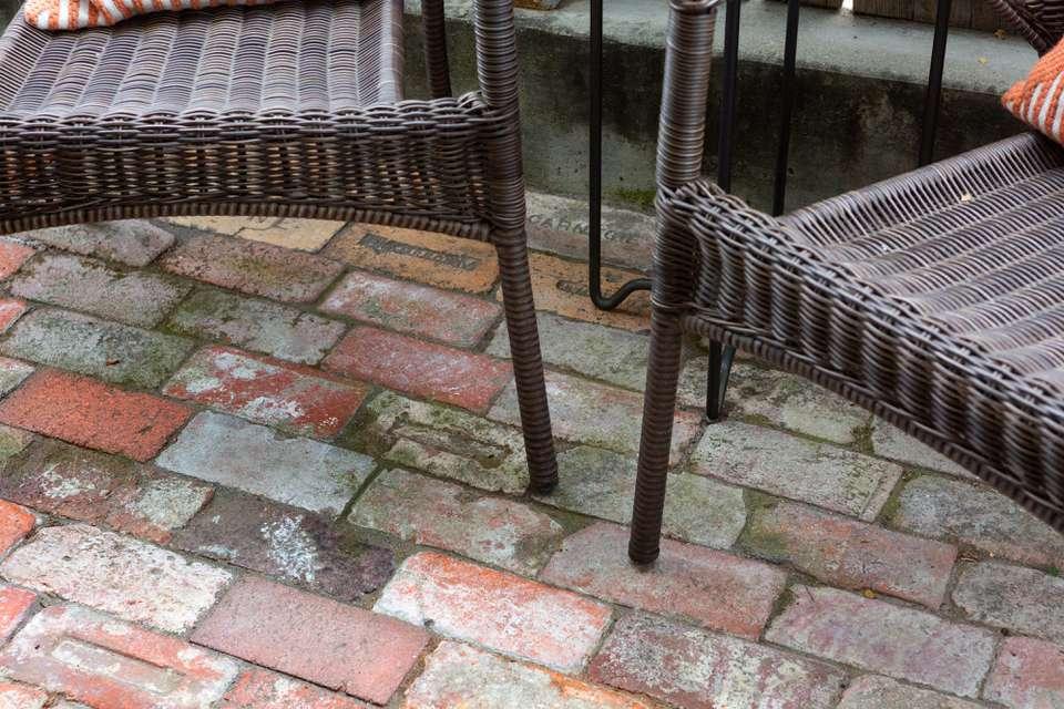 moss on patio bricks