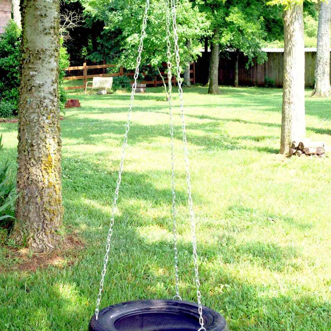A tire swing using chains