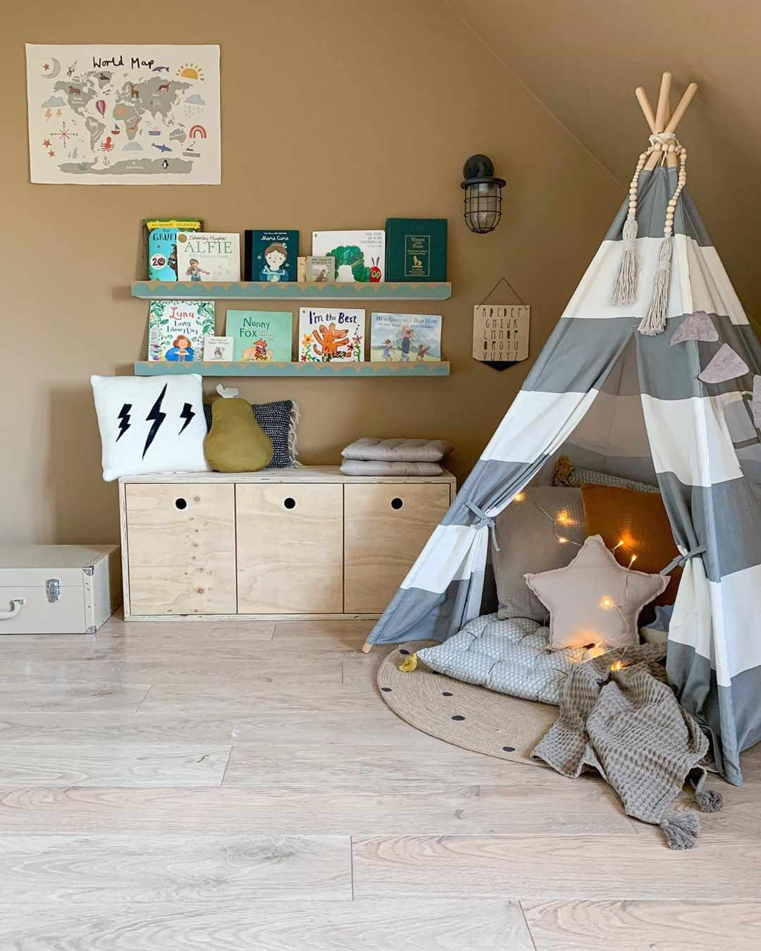Nursery with a gray and white tent