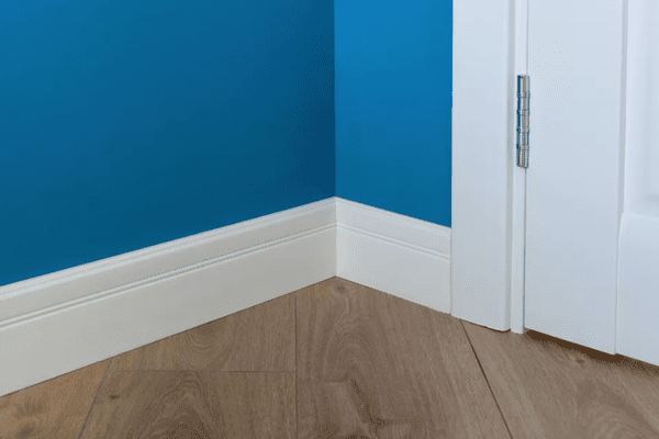 blue wall and white baseboard