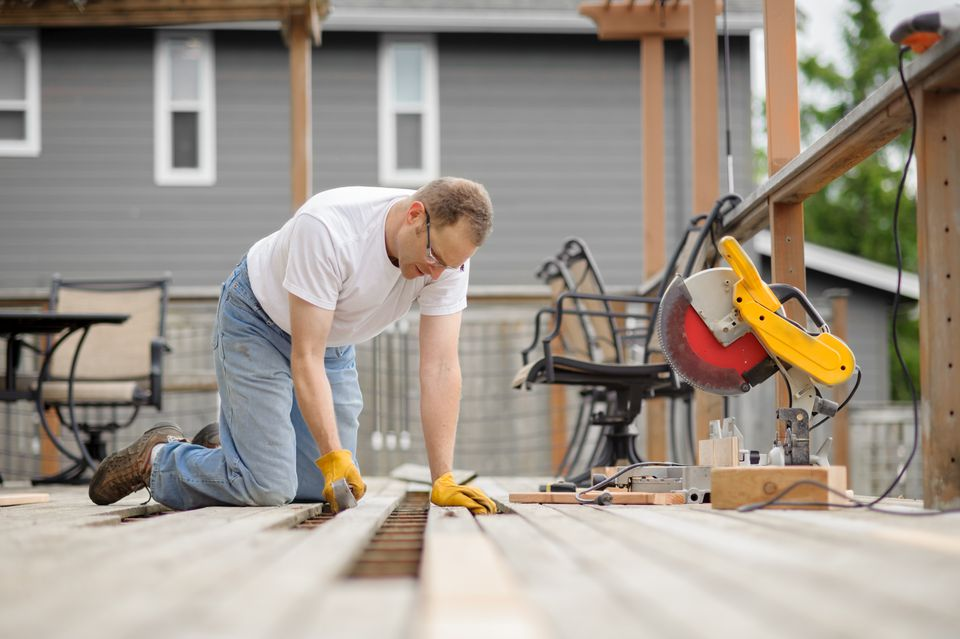 man building deck